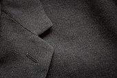 Closeup of a suit texture. Macro shot to a business coat