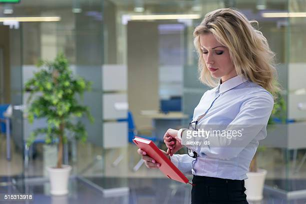 Elegant blonde businesswoman in office interior