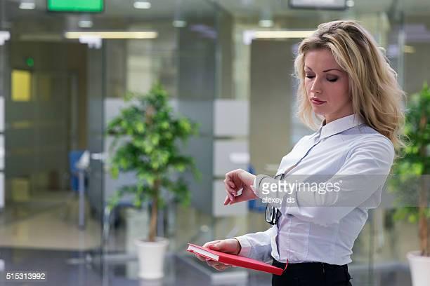 Elegant blonde businesswoman in office interior