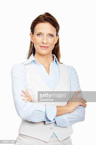 Elegant business woman standing confidently against white