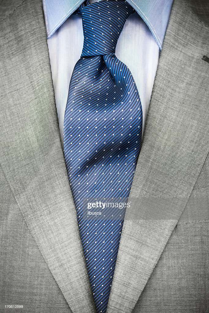 Elegant businessman close up on necktie