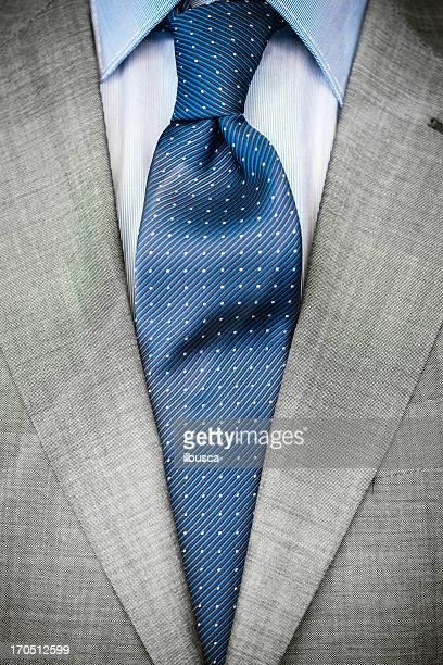 Elegant businessman close up on necktie