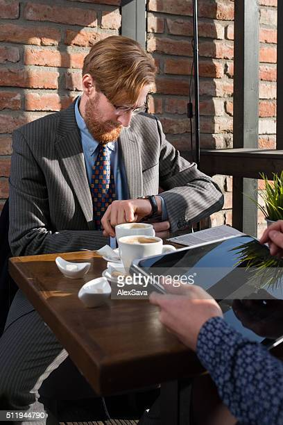 Elegant businessman having a meeting at a coffee shop