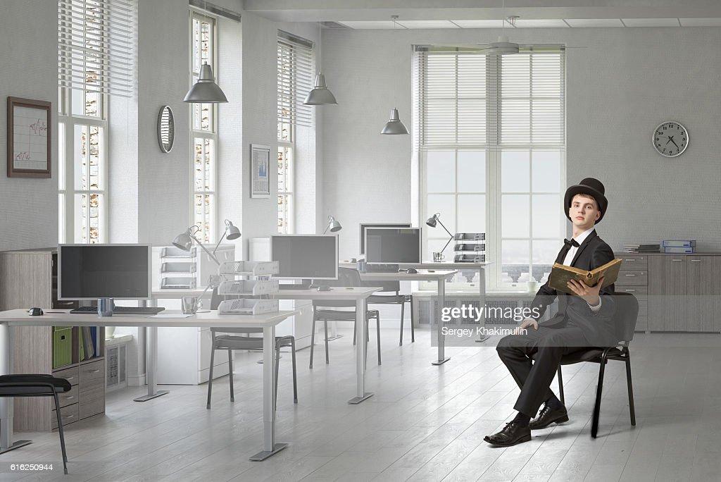 Elegant businessman read old book . Mixed media : Stock Photo