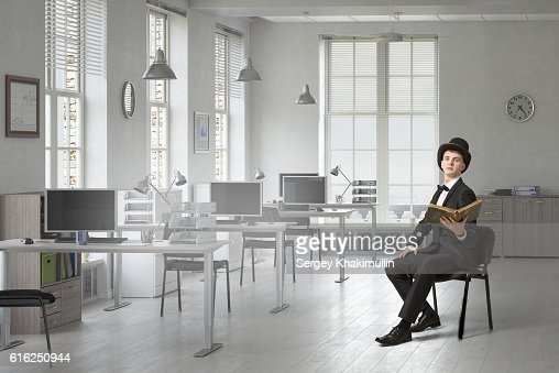 Elegant businessman read old book . Mixed media : Stock Photo