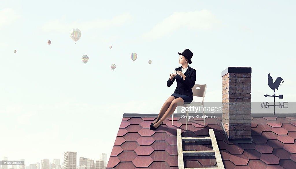 Elegant businesswoman in cylinder hat . Mixed media : Foto de stock