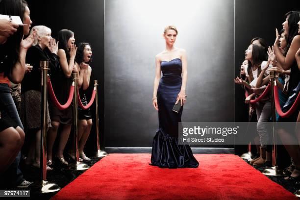 Elegant Caucasian woman posing on red carpet
