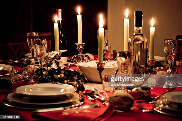 Elegant Christmas table lit by candles