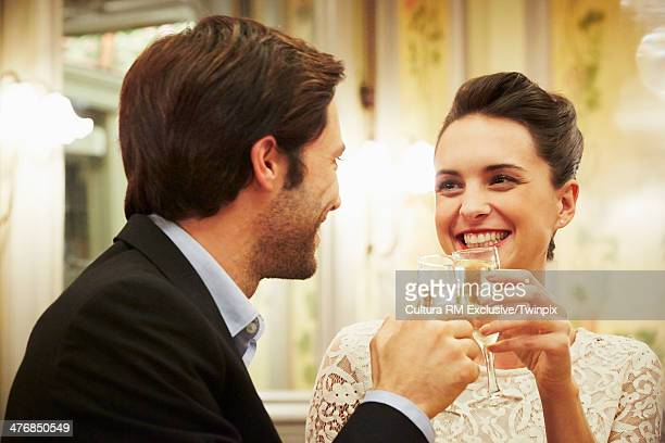 Elegant couple celebrating with champagne