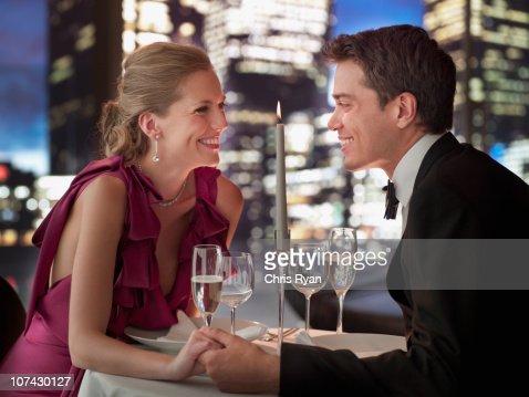 Elegant couple having dinner in restaurant : Stock Photo