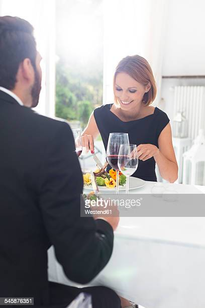 Elegant couple having dinner in restaurant