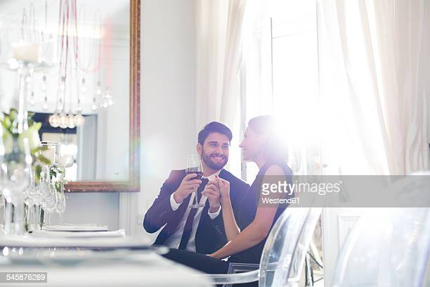 Elegant couple in restaurant