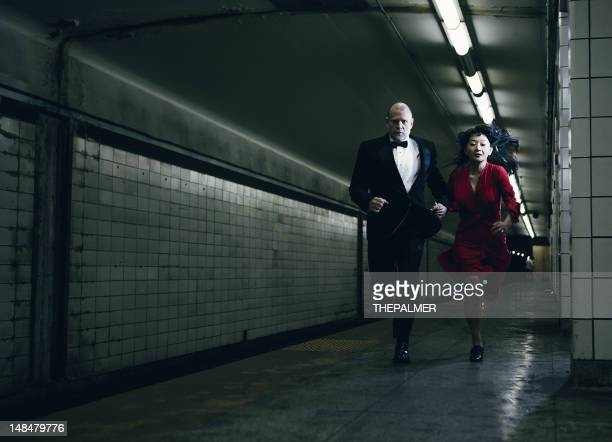 elegant couple running