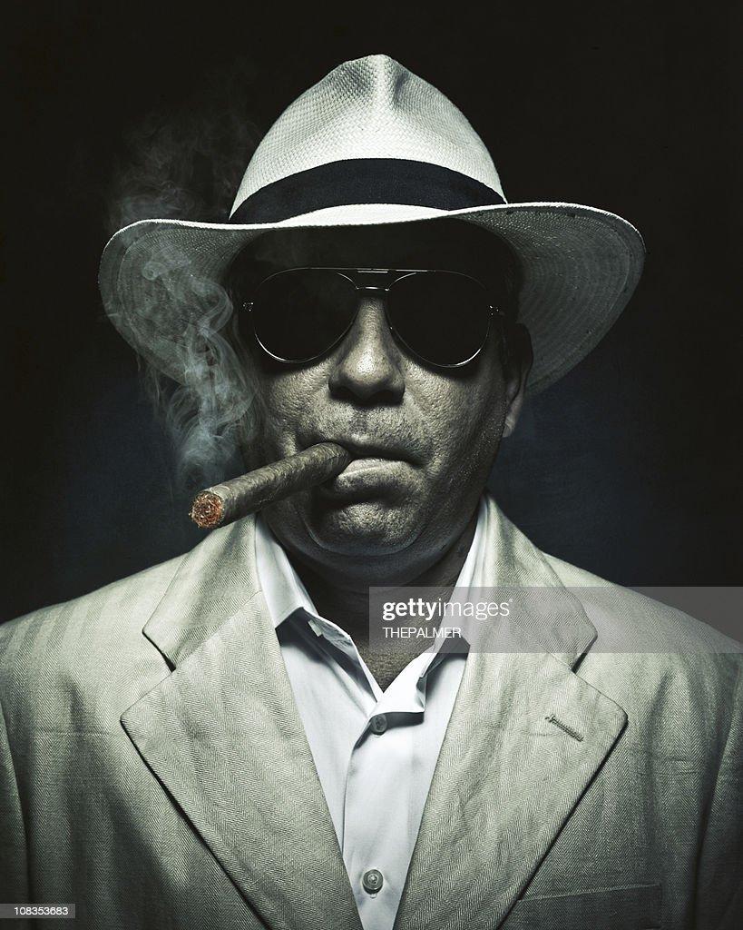 elegant cuban mysterious man smoking a cigar : Stock Photo