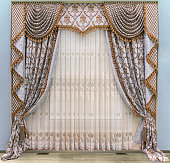 Elegant curtains in a classic, palace style. Semi-transparent tulle with floral ornament. Combined,  two-sided curtains with a lambrequin and a jabot