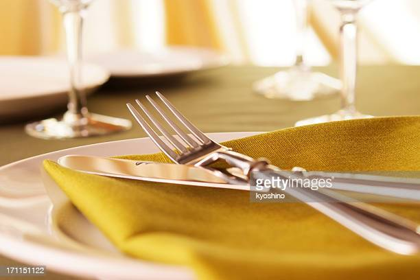 Elegant dinner table setting with shallow depth of field