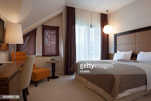 Elegant double bed hotel room : Stock Photo