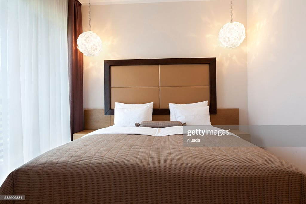 Elegant double bed hotel room : Stock Photo