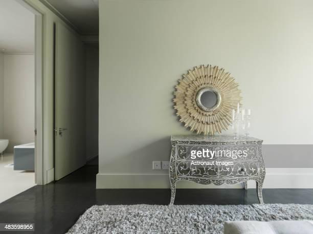 Elegant dresser and mirror in luxury bedroom