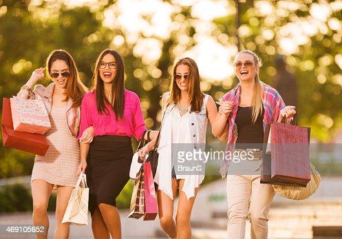 Elegant female friends shopping in the city.