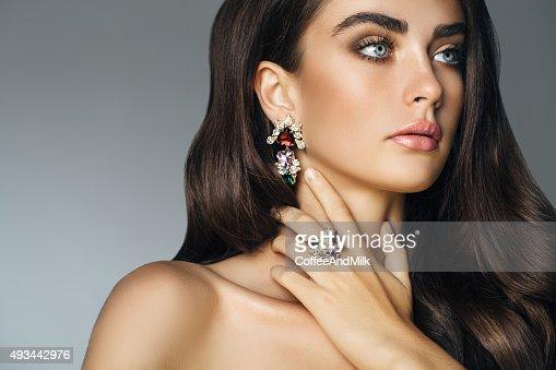 Elegant girl advertising jewelry
