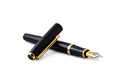 Elegant gold plated business fountain pen isolated on white with cap. Clipping path included. Copy space.