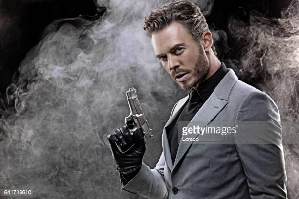 Elegant handsome gangster man in studio shot