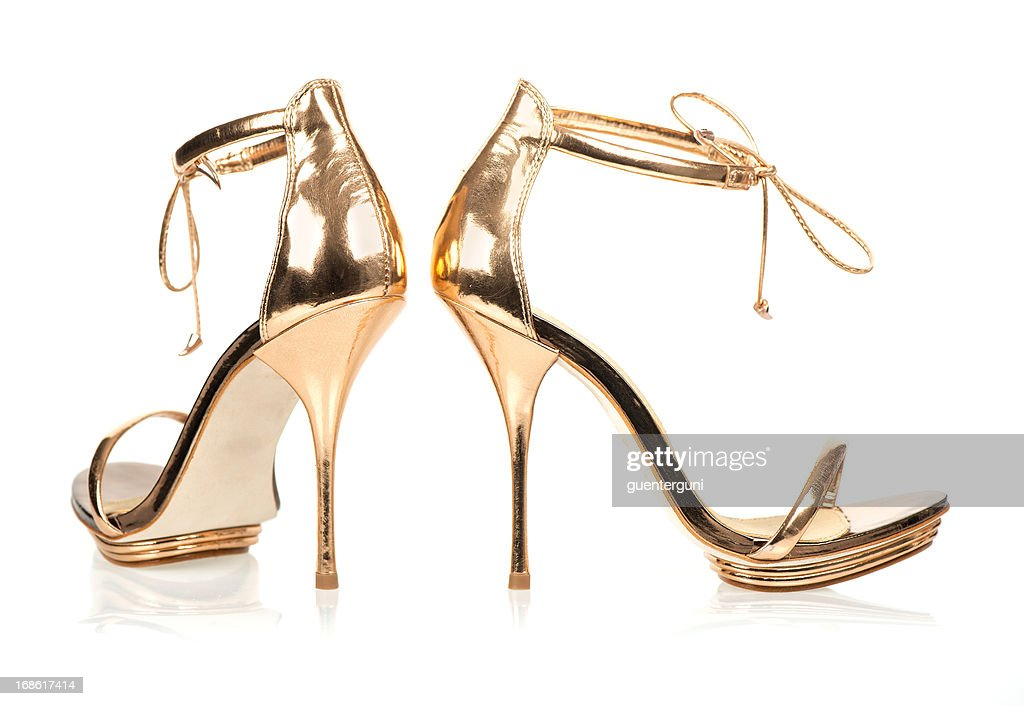 elegant high heels in metallic gold color with ankle straps stock photo getty images. Black Bedroom Furniture Sets. Home Design Ideas