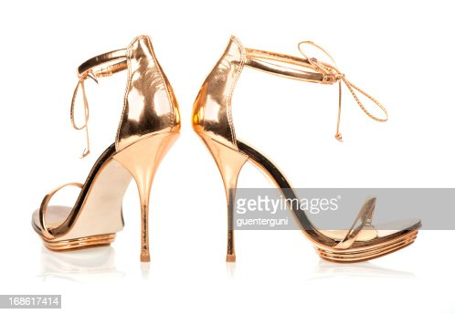 Elegant High Heels in metallic gold color with ankle straps