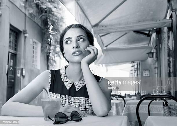 Elegant Italian girl drinking aperitif