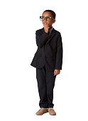 Elegant little thoughtful boy with glasses in business suit. Studio shot. Young boy posing, Full length body