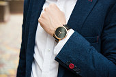 Elegant man in blue suit, business man's hand with fashion no brand wrist watch, men fashion and accessories closeup shot