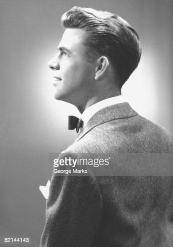 Elegant man posing in studio, (B&W) : Stock Photo