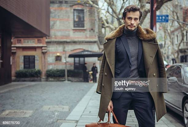 Elegant man with a travel bag