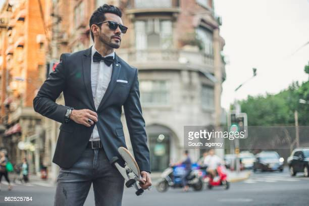 Elegant man with skateboard