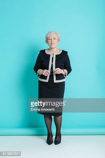 Elegant mature woman standing