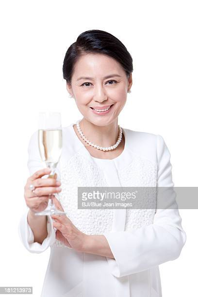 Elegant mature woman with champagne flute