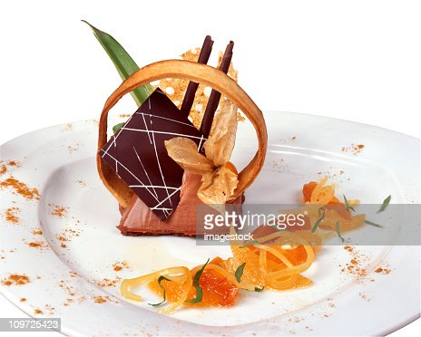 Elegant mousse with many garnishes on a white plate
