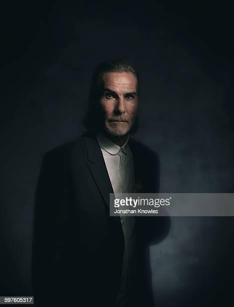 Elegant, older man with facial hair in make-up