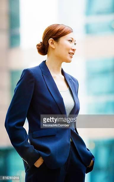Elegant professional Asian woman looking away