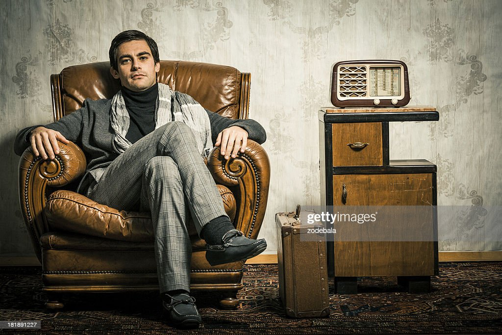 Plateau En Verre Pour Table Pas Cher : Elegant Retro Man Sitting In Vintage Room Stock Photo