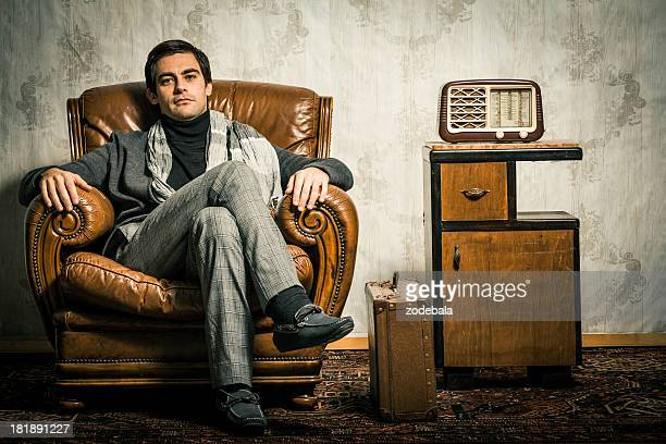 Elegant Retro Man Sitting in Vintage Room