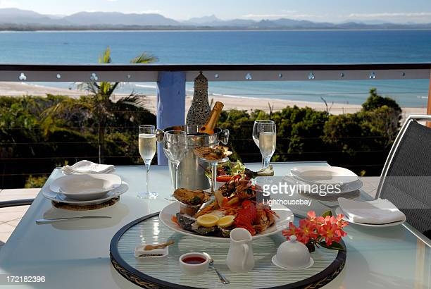 Elegant seafood dinner setting for two overlooking the bay
