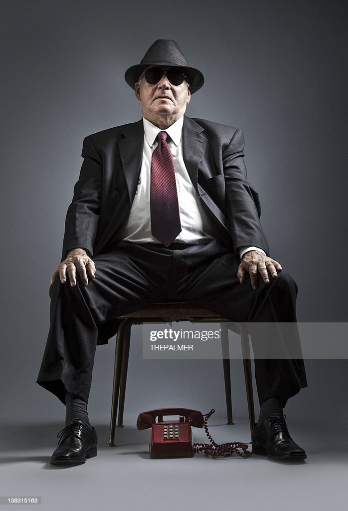elegant senior man waiting for a phone call