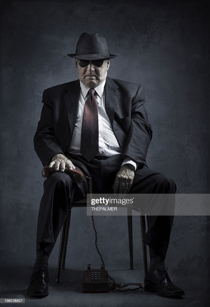 elegant senior man with vintage phone