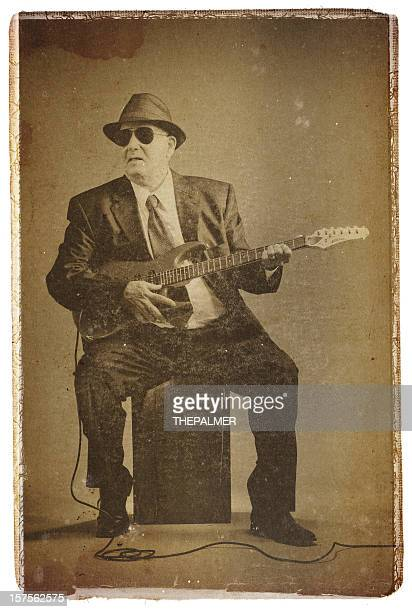 elegant senior playing an electric guitar