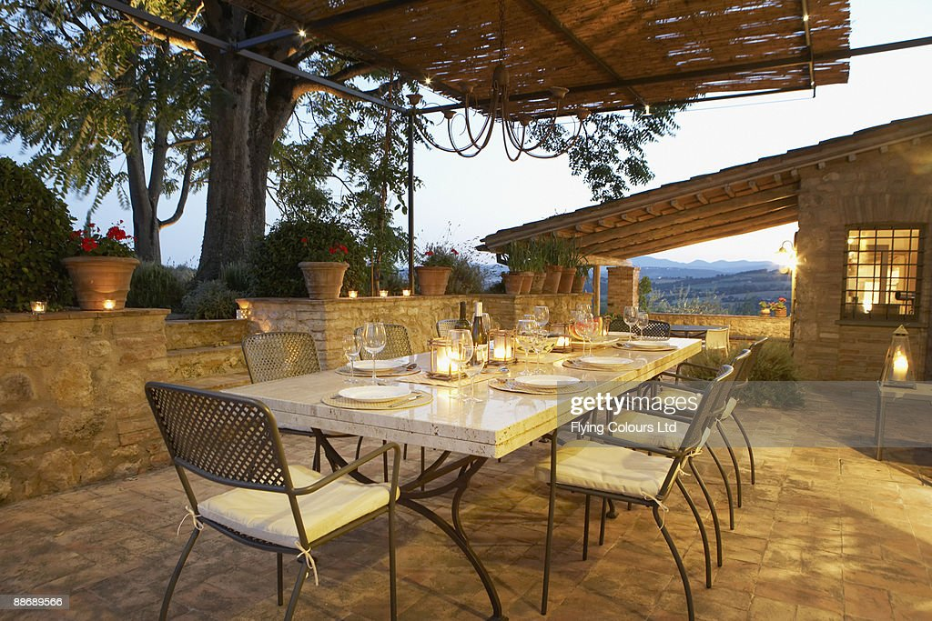 Elegant table set on patio, Umbria, Italy : Stock Photo