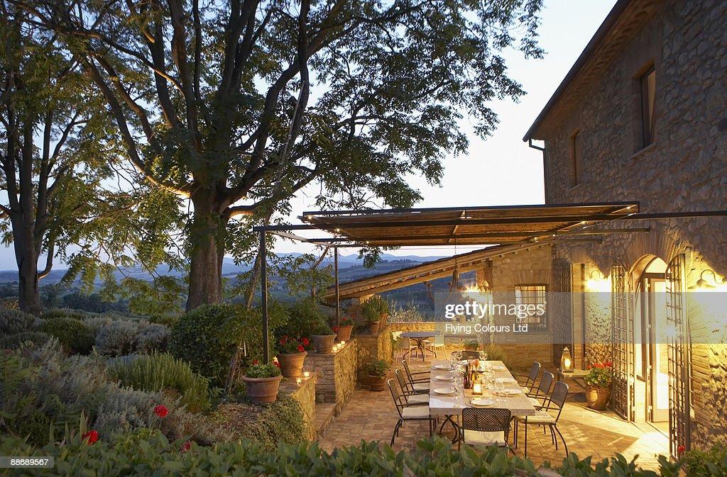 Elegant table set on patio, Umbria, Italy : Stock Photo