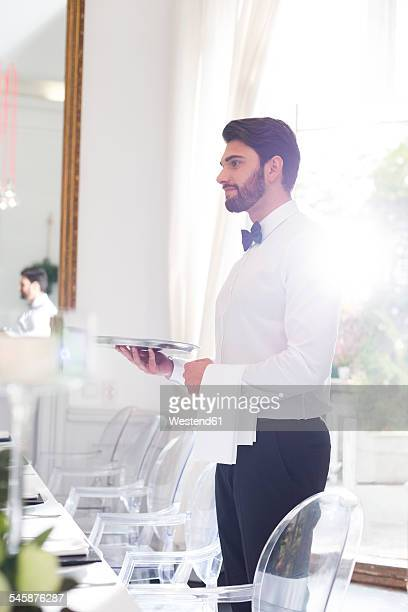 Elegant waiter in restaurant