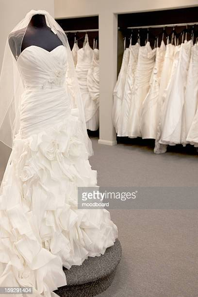 Elegant wedding dress displayed on mannequin in bridal store